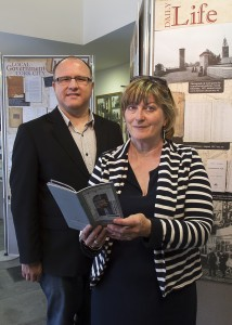 "Brian McGee Chief Archivist with one of 15 CorkDFAS volunteers assisting throughout Cork Heritage Week at the ""Moments in Time"" exhibition."